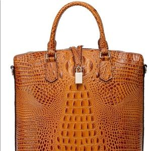 Almost New embossed leather tote bag